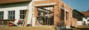 1988:<br>September: Anbau und Vergrößerung des Teilelagers & Bau eines Lackier- und Waschplatzes