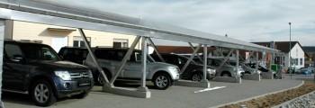 2012:<br>Errichtung von Solar-Carports auf dem Nachbargelände. Die Solarpanels speisen außerdem die erste Stromtankstelle in der Umgebung.